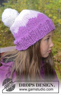 """Knitted DROPS hat with pompom and zig-zag pattern in """"Andes"""". Size 3-12 years. ~ DROPS Design"""