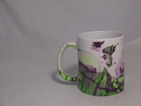 Dip dyed marbled white mug - Sprayed with a sealant, on the outside design only. This sealant makes these items top rack dishwasher safe, however for longer durability, please only hand wash these items. - The mug itself is dishwasher and microwave safe, although I strongly suggest hand washing and avoiding microwave use to preserve the paint.  Each Mug is created individually by hand dipping, never machine printed, so each one will be unique!  Please keep in mind that printed colors may…