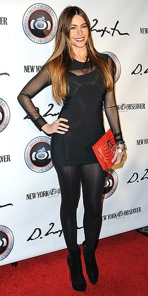 Another member of the Over 40 and Fabulous Club shows off her killer curves at the Domingo Zapata art event in N.Y.C. donning a sheer black mini, plus coordinating tights and heels and one pop of color via a red croc clutch.