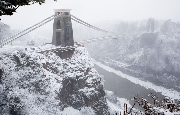 Standing firm: Brunel's masterpiece the Clifton suspension bridge in Bristol looks stunning surrounded by 15cm of snow
