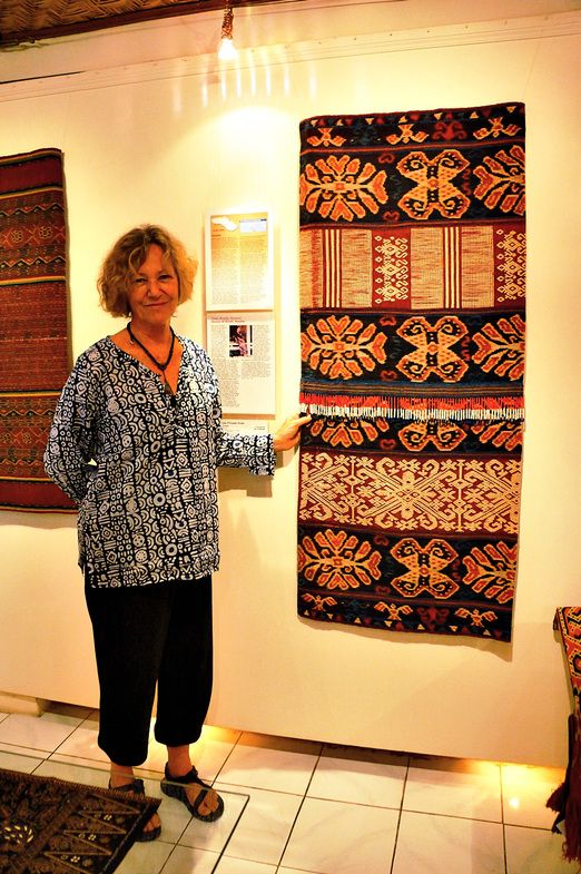 The queen's treasure: Jean Howe and one of her favorite textiles, given by Rambu Eti, a queen of the kingdom of Pau, Eas...