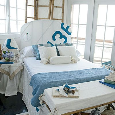 This bedroom features a custom slipcover that was made from recycled sails.: Beaches House, Nautical Bedrooms, House Style, Chic Interiors, Coastal Living, Upholstered Headboards, Guest Rooms, Beaches Style, Coastal Bedrooms