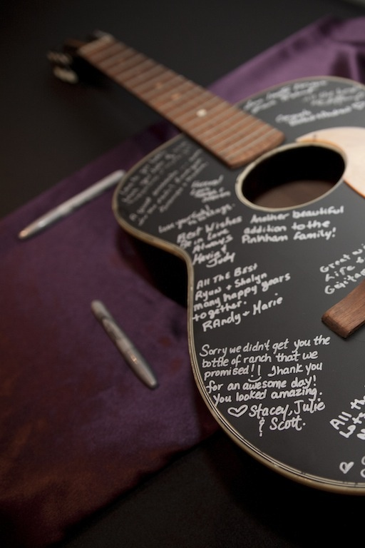 guitar guestbook for our wedding. We painted an old guitar, had guests sign with a silver sharpie, and we will be restringing it and hanging it as wall art in our home!