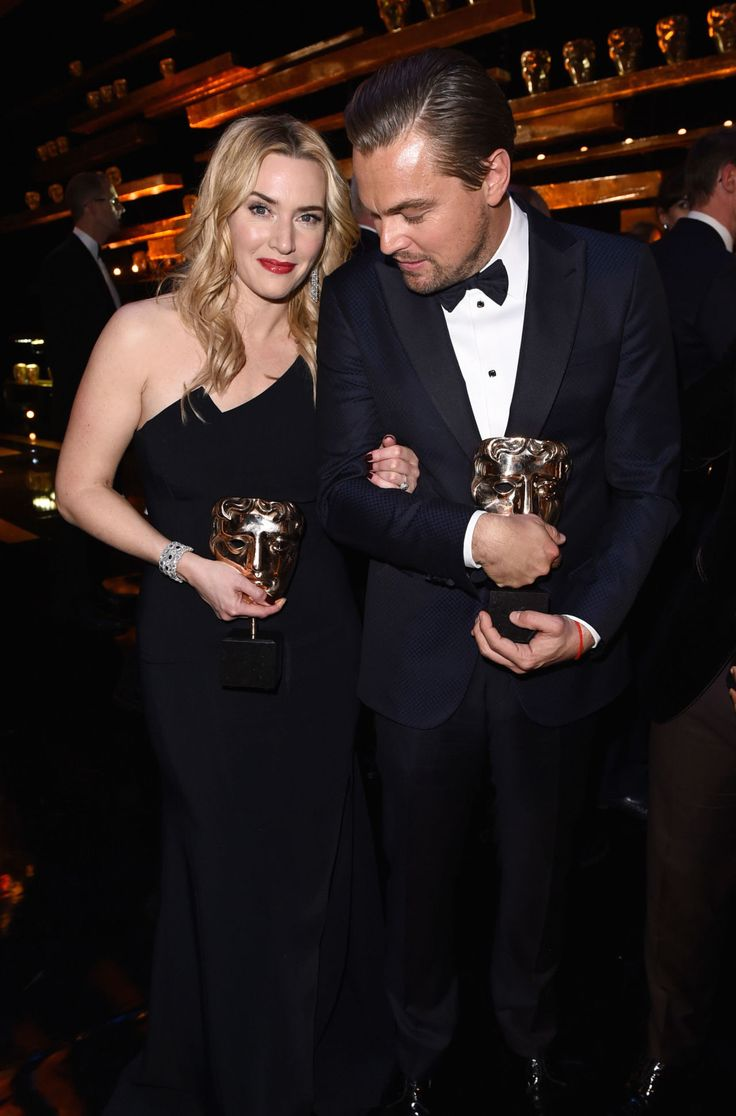 Kate Winslet and Leonardo DiCaprio pose with their BAFTAs in the winners room