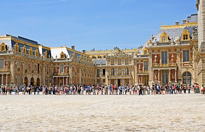 Sunny queuing outside the Palace of Versailles.