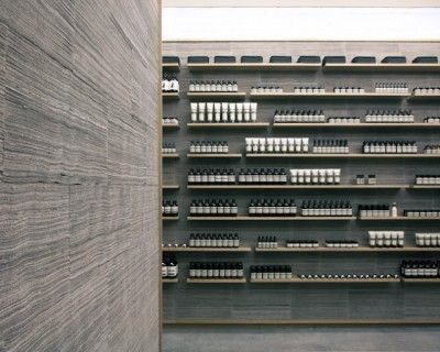 Aesop's new store— Succintly filled with oak shelves stocked with products aligned with spartan precision, the main feature of this space, however – and nearly unseen due to its very subtle texture -is the the concept ofnewsprint walls (stacked strips of newspapers held within a continuous oak wrapper), covering nearly every surface of the shop. Like paper, theywill age over time.