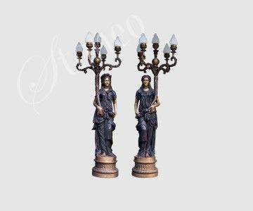 Rzymskie kobiety - świeczniki z brązu