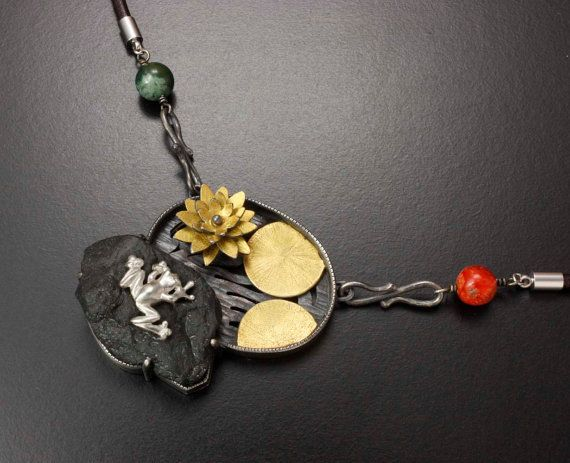 A frog on a rock by a water lily pendant by KAZNESQ on Etsy