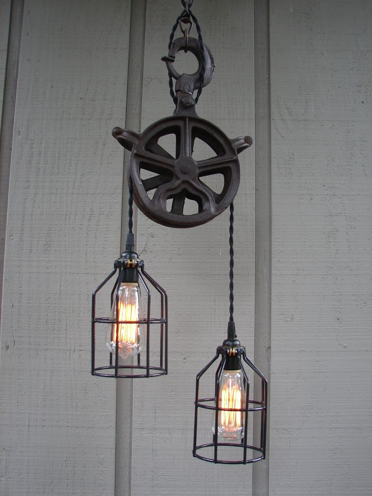 Upcycled Vintage Industrial Pulley Lighting Pendant with Bulb Cages. $276.00, via Etsy.