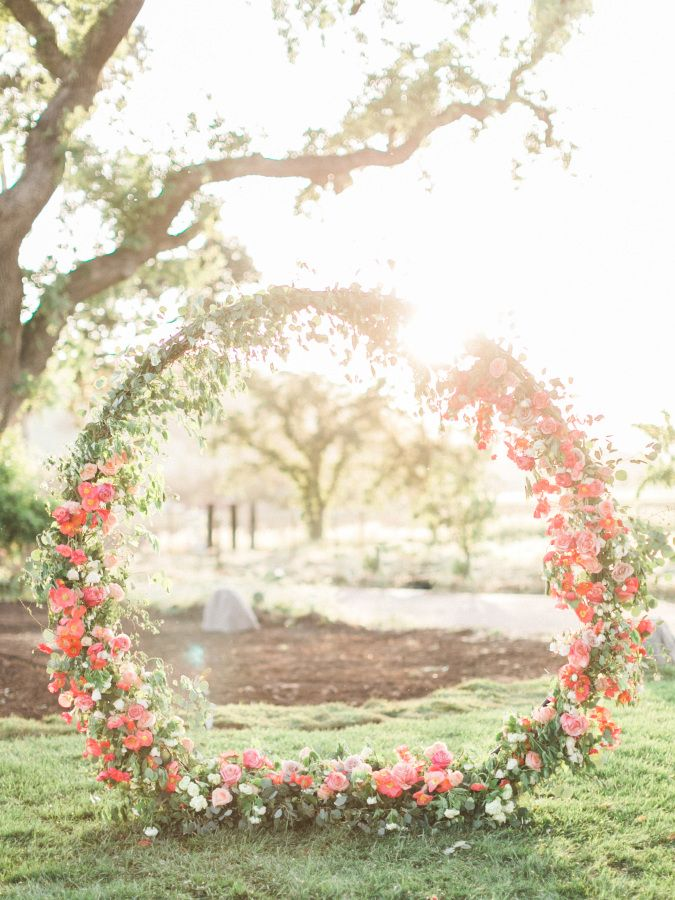 Leave it toCaroline Tranto send us an inspiration shoot so ridiculously pretty it can only be described as the girly wedding of your dreams. I mean, this dress, and that floral arch (!!!) are absolutely everything, and you can head to