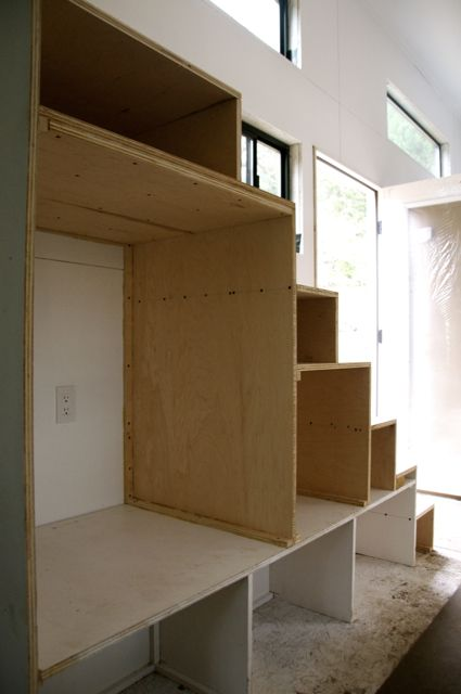 """Start with the big boxes. In this example, we have a large opening for a washer/dryer combo unit. For any opening larger than 24"""", double the 3/4"""" plywood with glue and screws to provide adequate support for the stairs."""