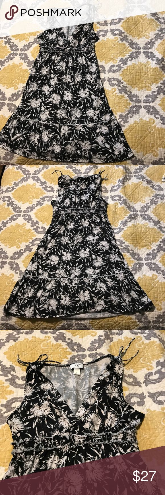 Ann Taylor Loft Dress Loft Dress. Black with white flowers all over. Size small petites. Flowy dress with an x neckline and ties at the shoulders with a cinched look. Worn a couple times. Dress is in good condition and is super cute for summer. Knee length LOFT Dresses High Low