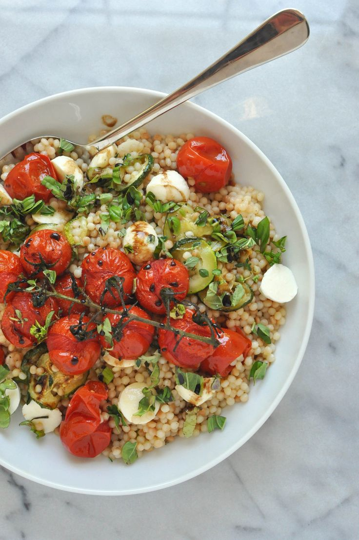 """This Israeli couscous salad with zucchini, mozzarella, and tomatoes is hearty and full of bright flavors. It's a delicious side dish or lunch option. Israeli couscous (called """"ptitim"""" in Hebrew and also sometimes pearl couscous) is a small toasted pasta that tastes quite similar"""