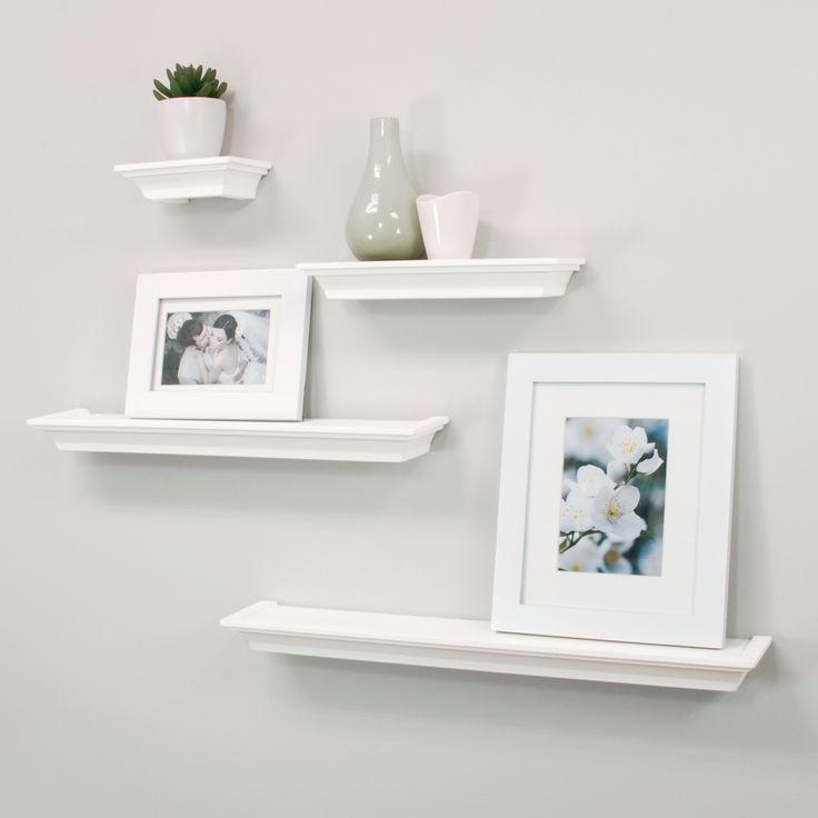 Features:  -Set of four contoured ledge style shelving.  -Various lengths create an eclectic look.  Finish: -Black, White.  Frame Material: -Plastic.  Number of Items Included: -4.  Shelf Material: -P