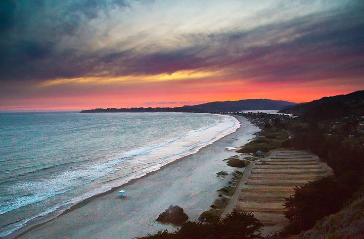 A little farther south, three-mile-long Stinson Beach never looks better than under the glow of thesetting sun.