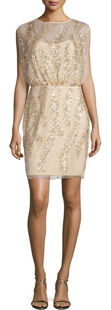 Sleeveless embellished tulle cocktail dress by Aidan Mattox. Aidan Mattox tulle cocktail dress with patterned embellishing. Round neckline; keyhole back. Sleeveless; full shoulde...
