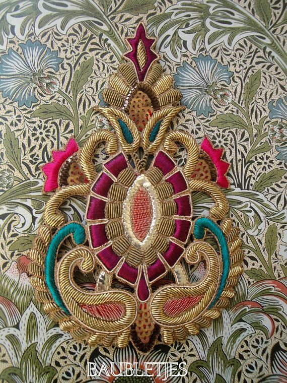 Colourful goldwork embroidery, close-up (detail): gold bullion and silk on canvas applique