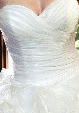 Wedding dresses: Sweetheart neckline, detailed body and fuller skirt