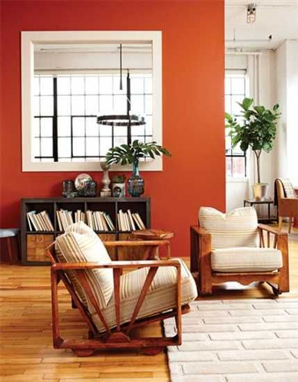 orange wall paint and shelves with wooden doors