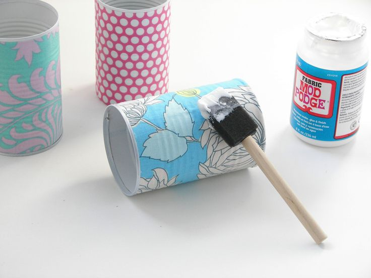 recycled tin cans with scrap book paper and mod podge!
