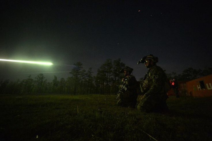Canadian special operations regiment members call in close-air support from their US Air Force allies during Emerald Warrior 2013 April 26, 2013, at Hurlburt Field, Fla.