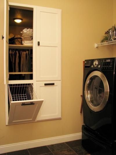 A laundry room next to the master bedroom. The hamper goes into the master closet, and pulls out into the laundry room. Separate shelves for folded clean laundry.    This is pretty cool.