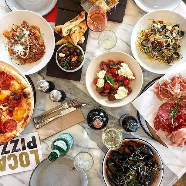 """""""What an amazing spread at @localepizzeriadeakin!"""" Instagrammer @ashiebarnes shared this delicious snapshot of a recent meal at a local pizzeria with a focus on eating, relaxing, celebrating and socialising with family and friends. The smart yet simple menu features ingredients prepared onsite including hand-made pasta and pizza cooked in a woodfired oven. #visitcanberra #onegoodthingafteranother"""