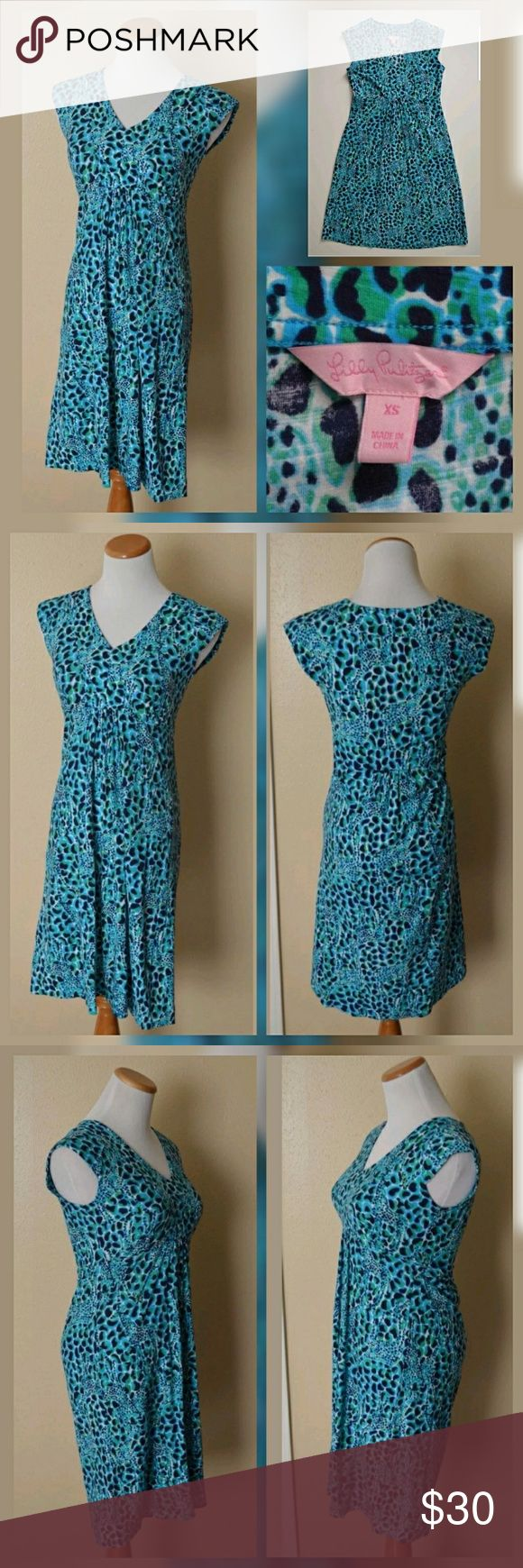 """Lilly Pulitzer Garnet Dress Giraffe sz xs For your consideration is a Lilly Pulitzer """"Garnet Dress"""" in size extra small. Giraffe print. Blue, green, and white multi-color print. V-neck. Cap sleeve. 100% cotton.  Excellent condition!   Measurements laying flat:  Bust (armpit to armpit): 15.75""""  Waist: 13.75""""  Hips: approx 16.5  Bottom hem width: 23.25""""  Total length (top of shoulder to bottom hem): 35.25"""" Lilly Pulitzer Dresses"""