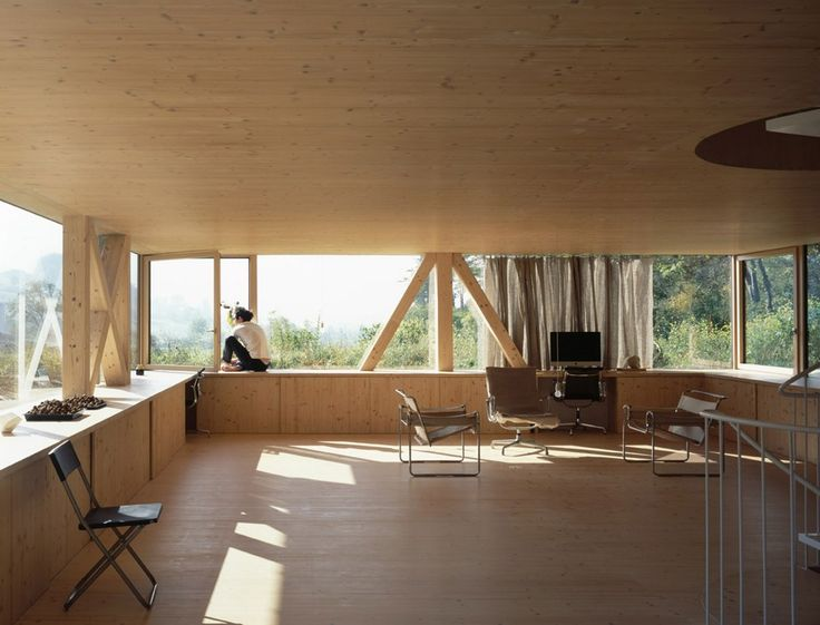 Swiss architect Pascal Flammer created a home that every nature lover dreams of. The modern wooden house of minimal form overlooks the stunning forestal mountains, making it the perfect spot for nature observation.