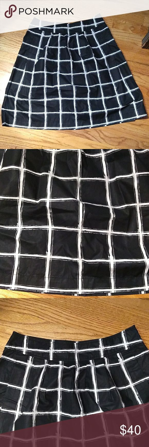 Michael Kors A line skirt Black with white window pane pattern. Zipper on side. 100% cotton. Pockets, but seal has never been broken. Excellent condition. Approx measurements: across waist, 15 in; length, 22.25 in. Michael Kors Skirts A-Line or Full