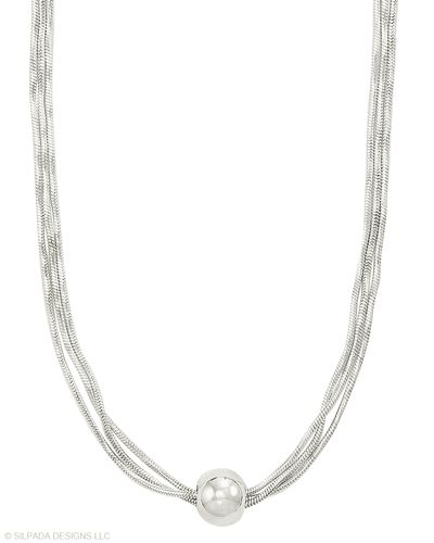These three delicate strands are Italian-made and gathered by a single bead. Sterling Silver.