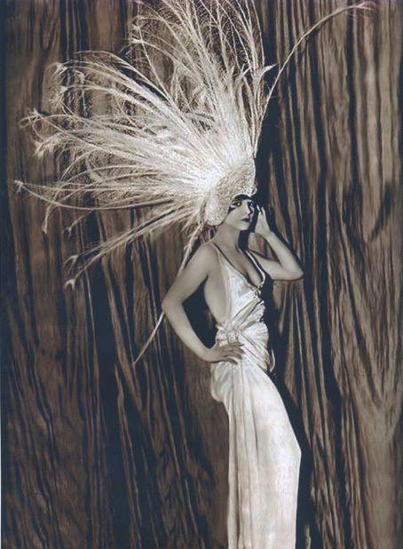 Florenz Ziegfeld's theatrical spectaculars known as the Ziegfeld Follies, were based on the Folies Bergère of Paris...   Erte costumes and sets were featured in the Ziegfeld Follies of 1923.  brooksfeathers.jpg 454×618 pixels