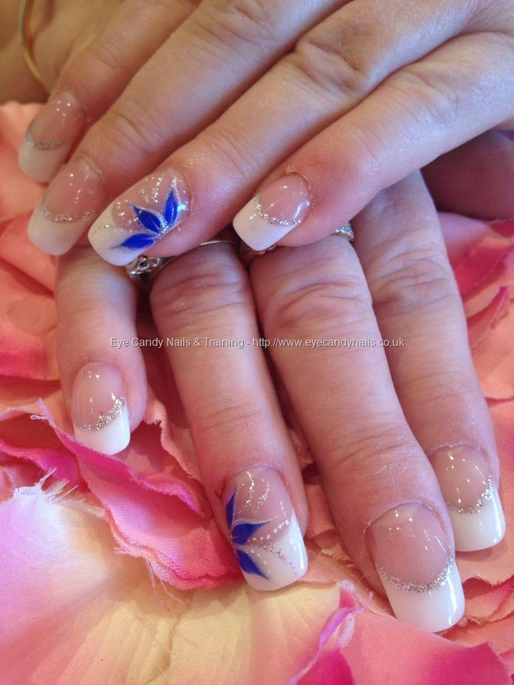 White sculptured acrylic tips with blue freehand nail art
