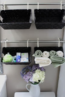 Bathroom storage baskets...over the toilet instead of the standard toilet shelving...love it