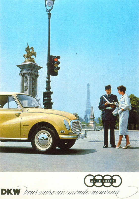 a DKW in Paris..Notice the logo??? It is still be used today by the successor company to Auto Union(whch DKW was a part along with Horch Wanderer and Audi) Audi AG which,since 1965 has been a part of Volkswagen