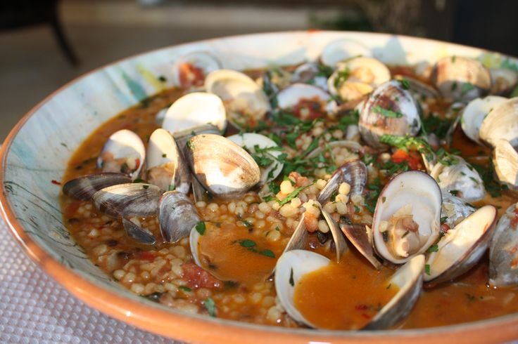 Sardinian Fregola (like giant couscous) with clams. Fantastic warming seafood dish from the wonderful Italian Island.