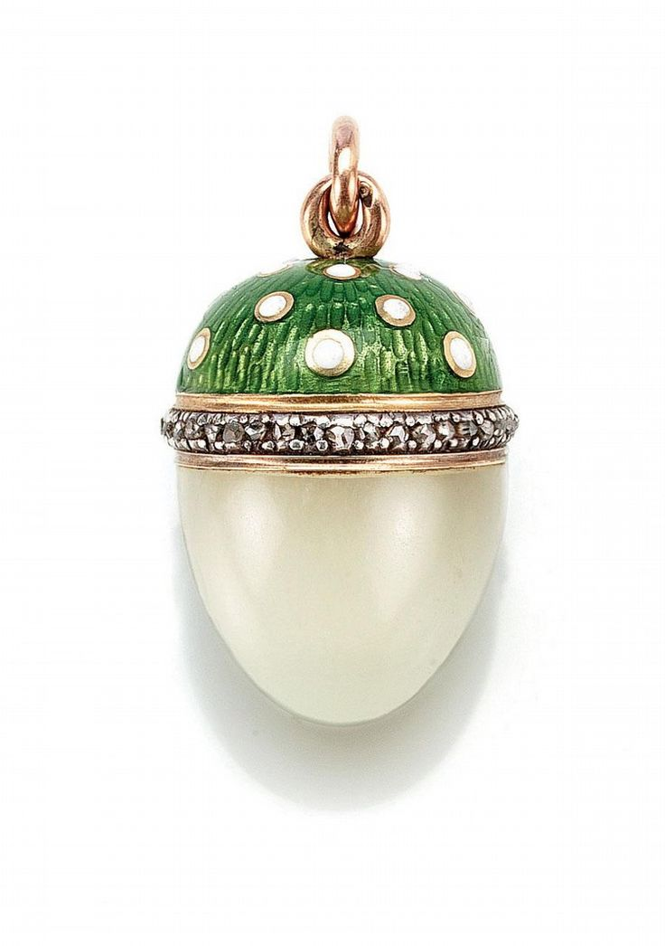 A FABERGÉ GOLD, DIAMOND, ENAMEL AND BOWENITE EGG PENDANT, WORKMASTER MICHAEL PERCHIN, CIRCA 1900 - the top enamelled with white dots on a translucent green ground, rose-cut diamond border, the base of bowenite, with workmaster's initials, 56 standard. via Sotheby's.