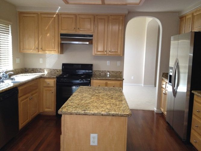 Kitchen With Granite Counters Stainless Steel Refrigerator Black Appliance And Maple Cabinets