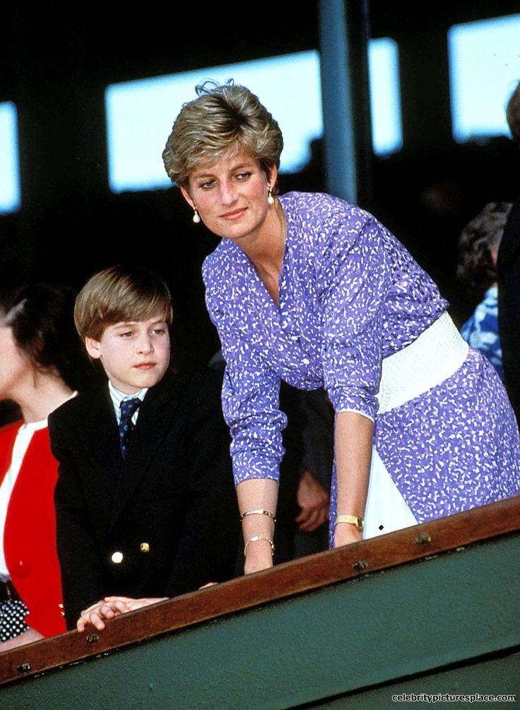 July 1991: Prince William stands with his mother Princess Diana in the Royal Box on Centre Court at Wimbledon, as Steffi Graf wins the Women's Singles Championship.