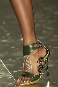 Fendi.  Not only do I love shoes, I love awesome shoes.  Not only awesome shoes but awesome shoes that are green!!  If only. . . . . .oh I think I could actually wear these!  :-)