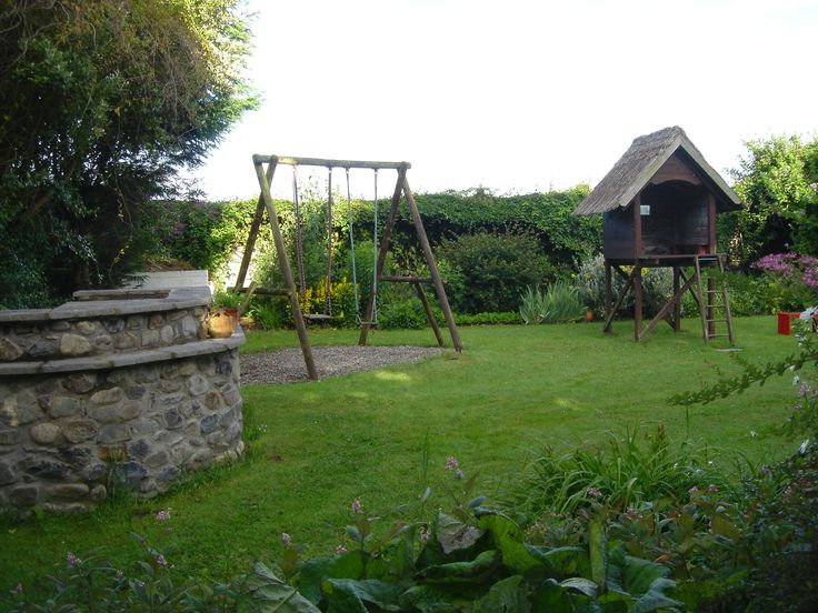 Children's play area with swings, tree house and play house.... exclusive to our guests only.