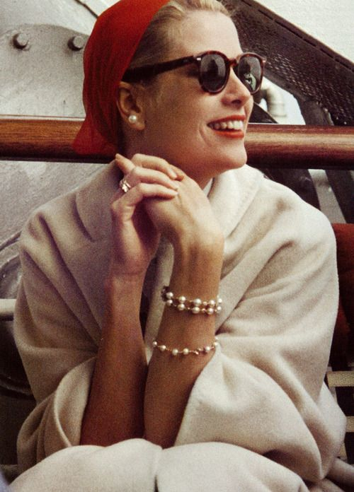 Grace Kelly, bracelets, red beret, pearl earrings, sunglasses, white coat, red lips