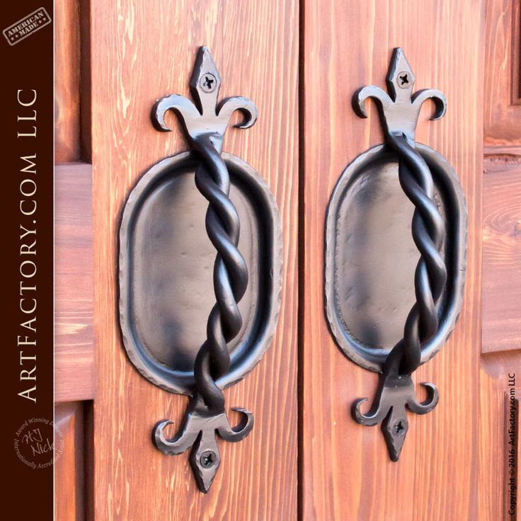 Handcrafted iron door pulls on Custom Exterior Door EDD1492