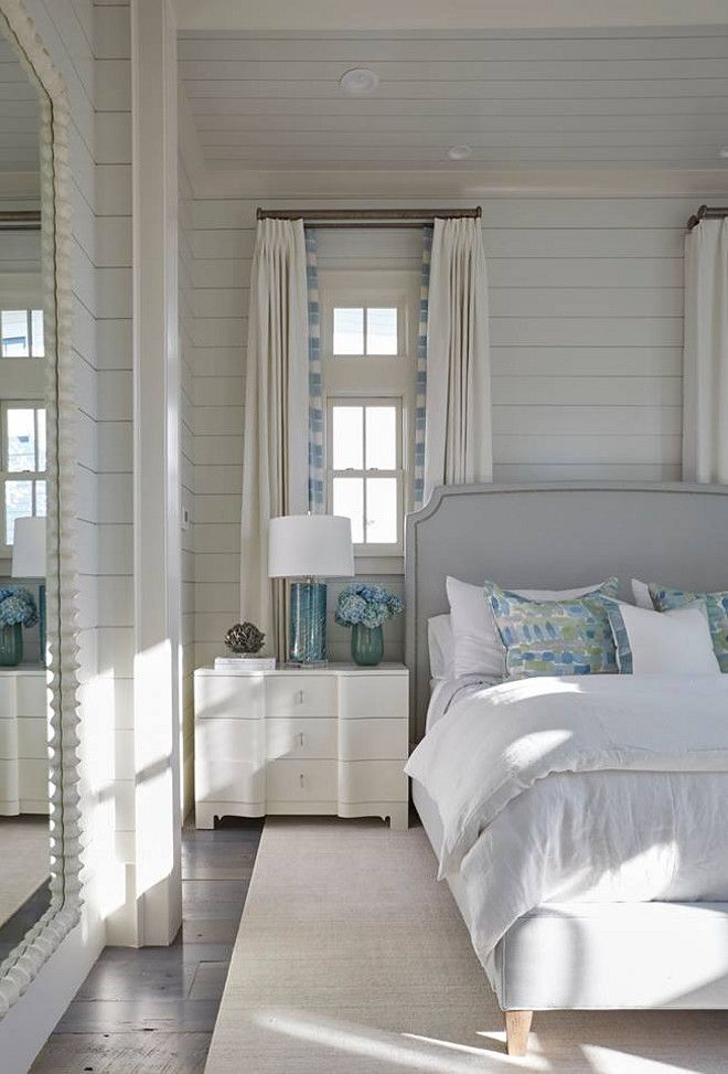 The shiplap walls are painted in a soft grey color.
