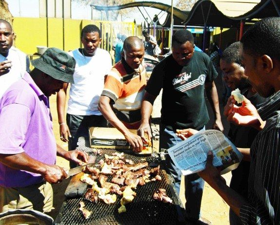 Serving mystery meat kapana in Namibia.  It may be ass