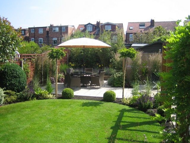 circular lawn and patio in this garden