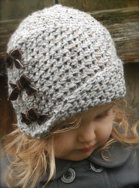Love the idea of taking a simple knitted hat and making it so cutesy with little velvet bows!