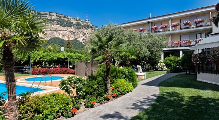 Sporthotel Villa Stella Nago-Torbole Hotel Villa Stella is a 15-minute stroll from Lake Garda and 800 metres from Torbole's town centre. It offers an outdoor swimming pool, a wellness centre, and sport activities.