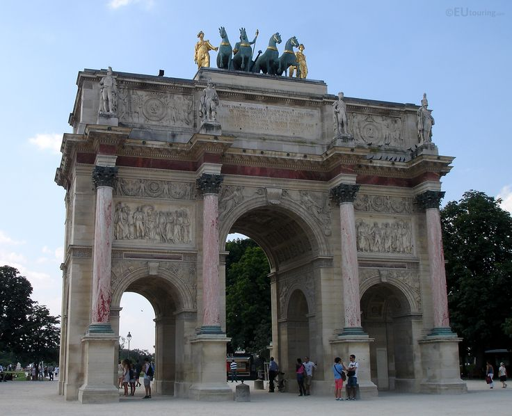 The lesser known Arc de Triomphe du Carrousel, near the Louvre, featuring golden statues and sculptures.  Wish to learn more? Look at www.eutouring.com/images_arc_de_triomphe_du_carrousel.html