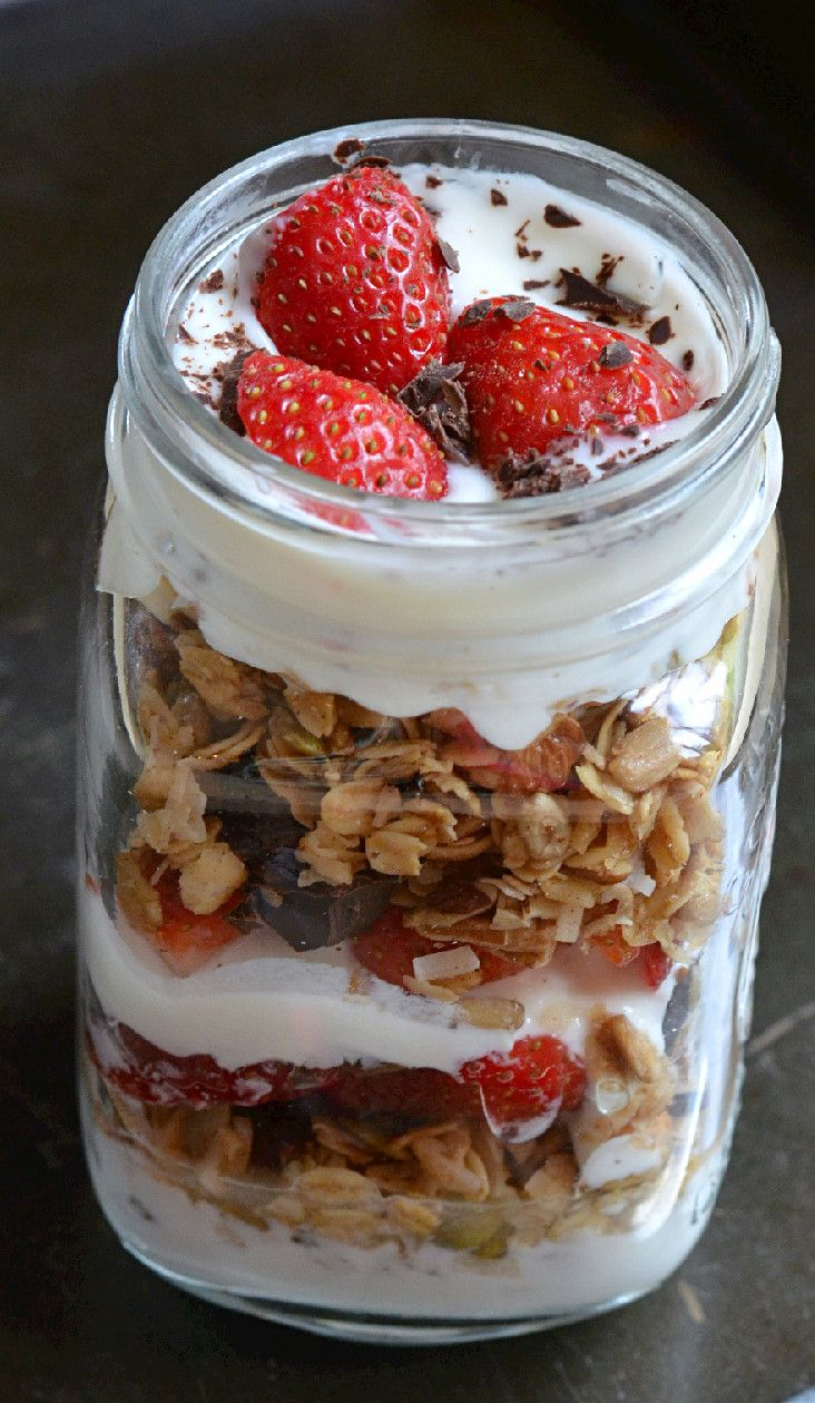 Delicious organic yogurt layered with homemade granola, fresh organic strawberries and chunks of dark organic chocolate. Great start to the day or a snack!